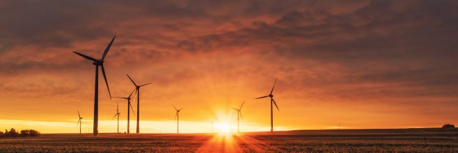 Photo of wind turbines promoting jobs in renewable energy sector